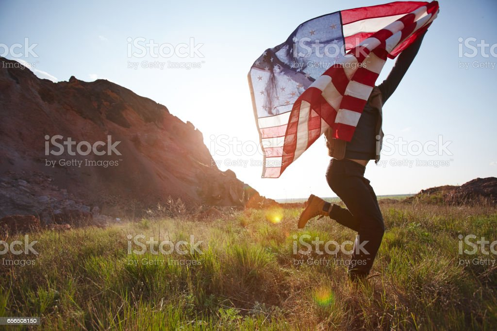 Joyful Man Running with USA Flag stock photo