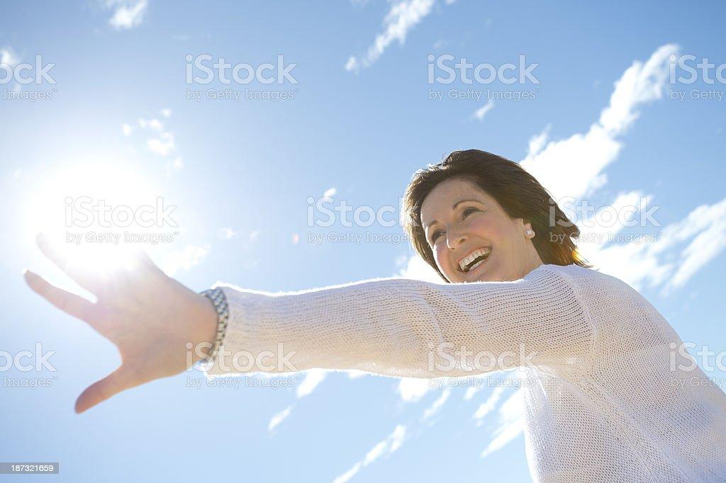 Joyful mature woman laughing royalty-free stock photo