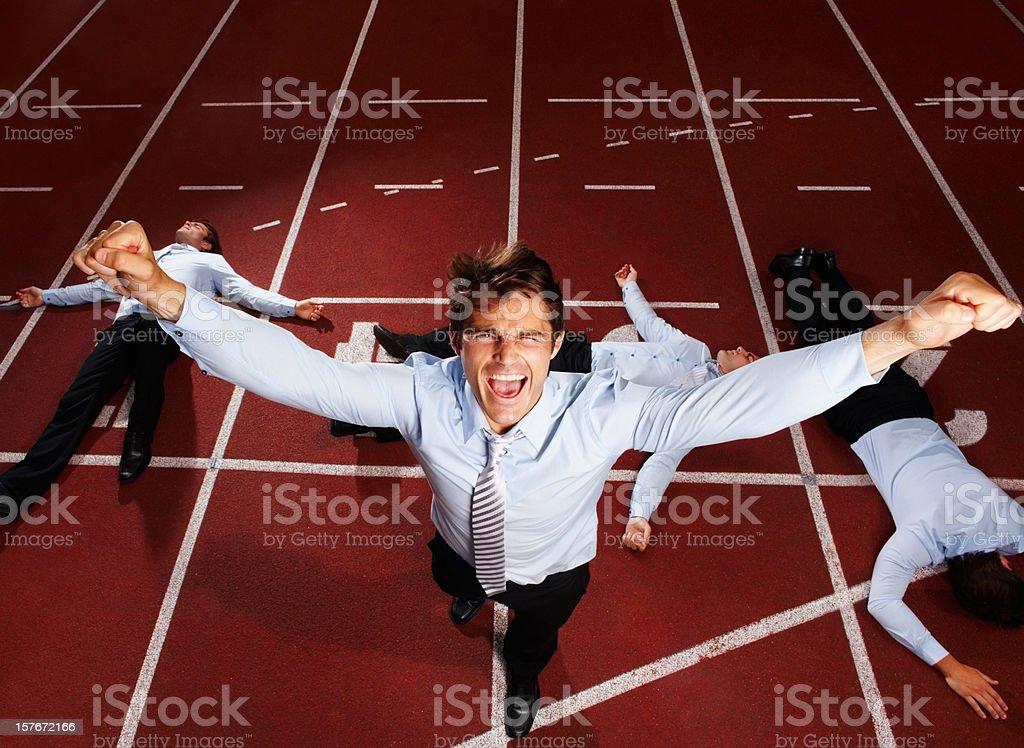 Joyful middle aged executive winning a business race stock photo