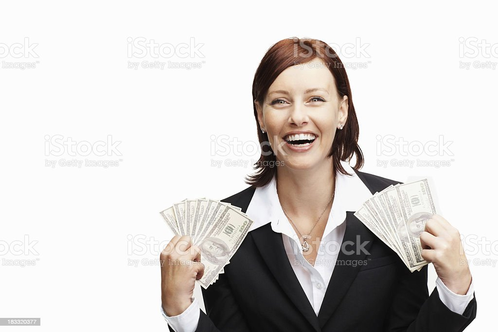 Joyful middle aged woman holding currency notes royalty-free stock photo
