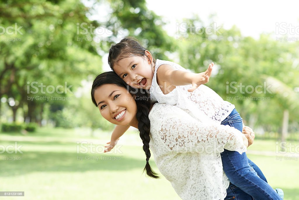 Joyful mother and daughter stock photo