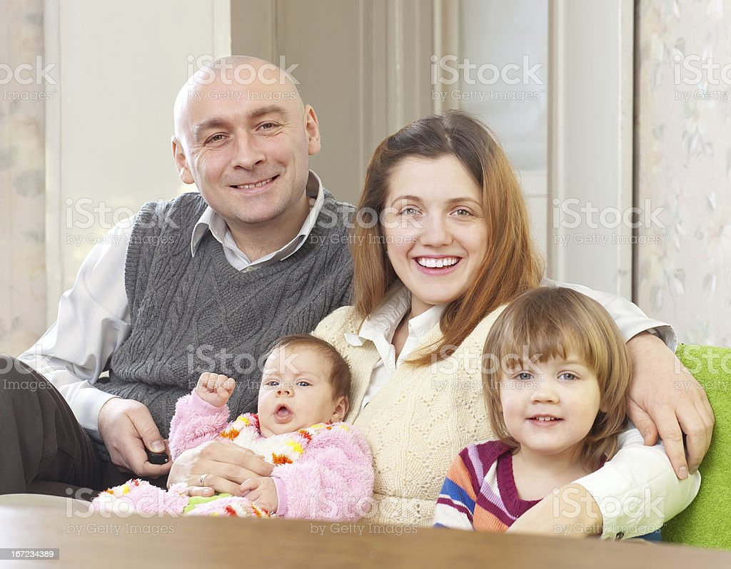 joyful parents with their two kids royalty-free stock photo