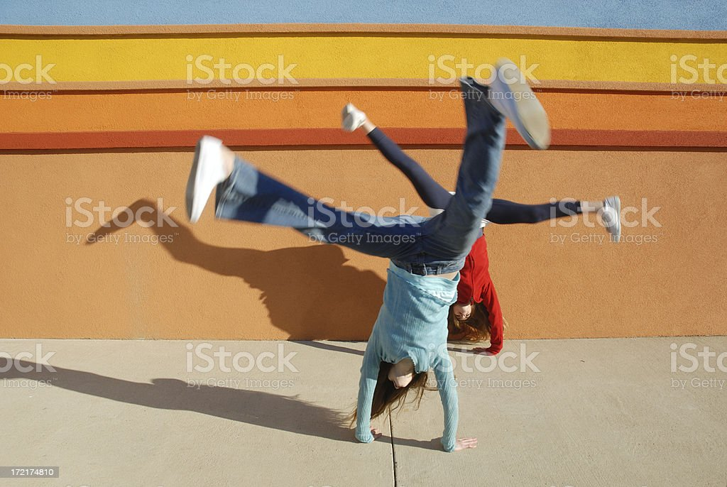 Joyful Twin Cartwheels royalty-free stock photo
