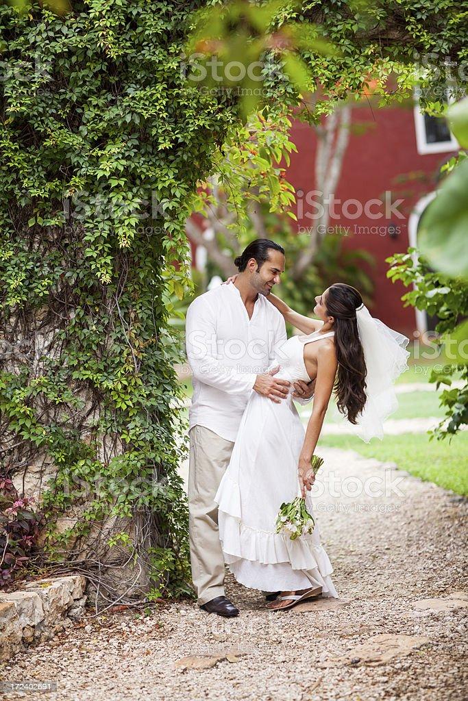 Joyful wedding couple dancing royalty-free stock photo