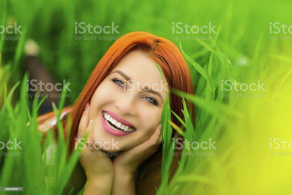 joyful woman in grass royalty-free stock photo
