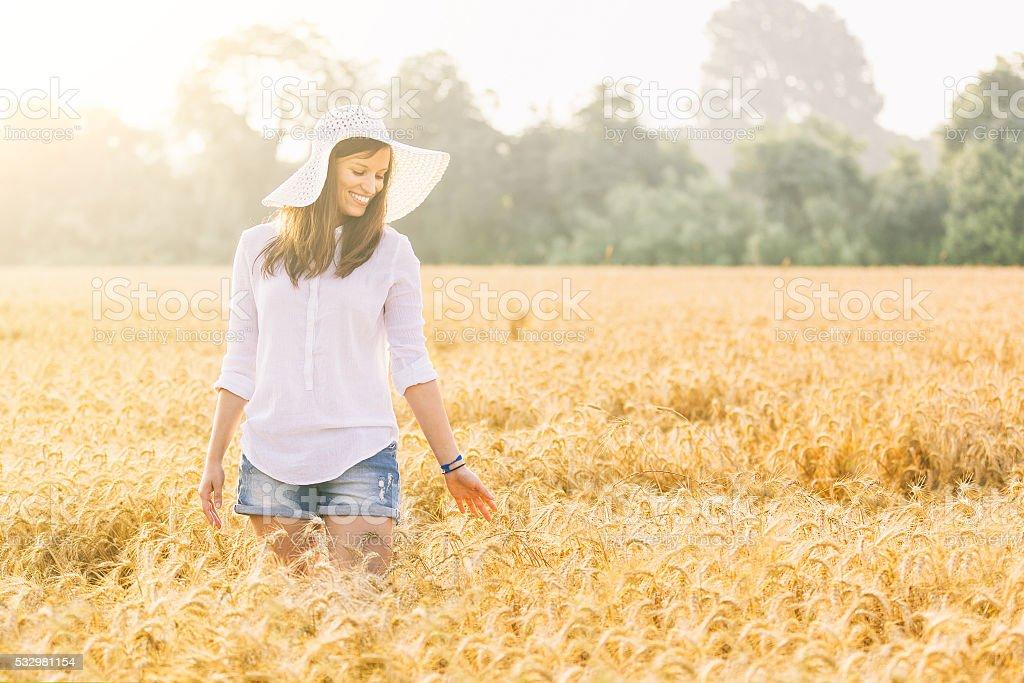 Joyful woman in the countryside stock photo