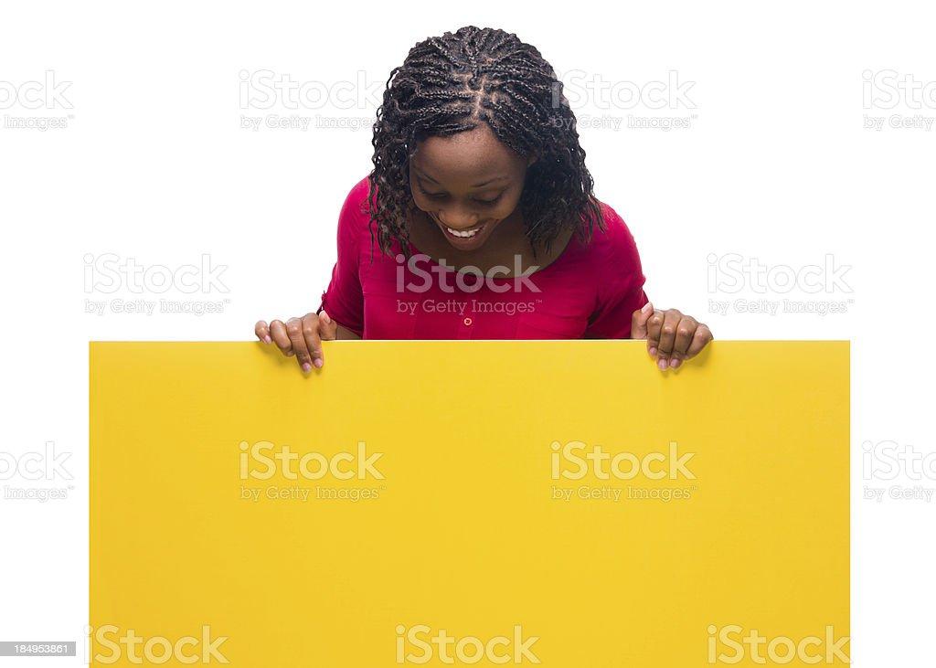 Joyful woman looking at sign royalty-free stock photo