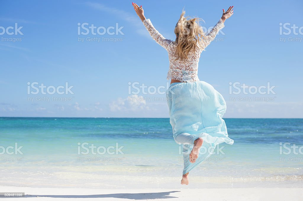 Joyful woman on the beach stock photo