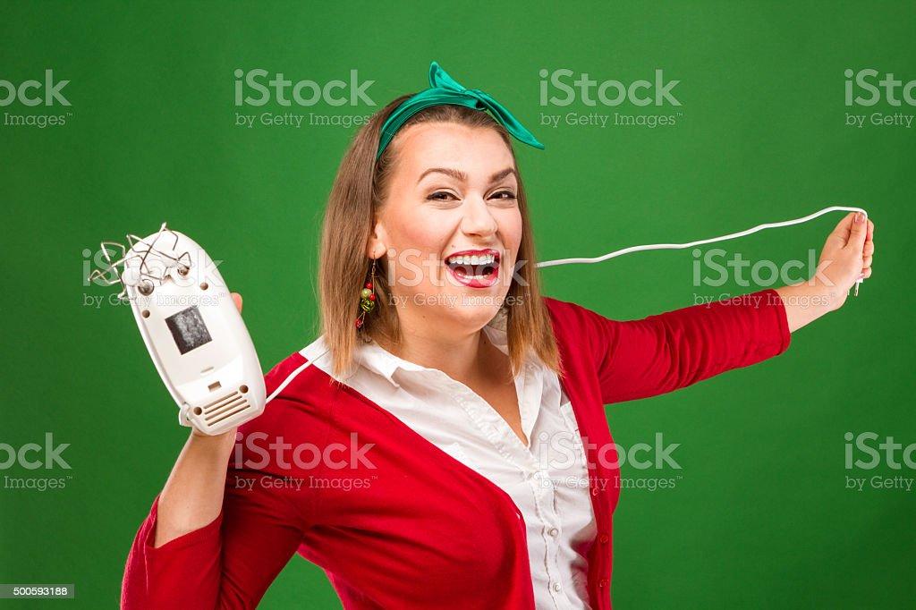Joyful woman with a mixer royalty-free stock photo