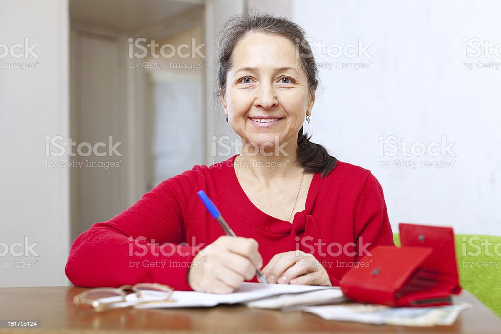 joyful  woman with bill and money royalty-free stock photo