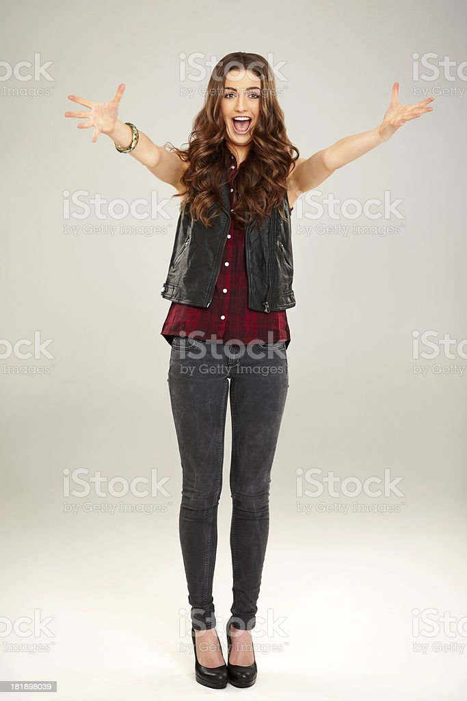 Joyful young female about to grab you royalty-free stock photo