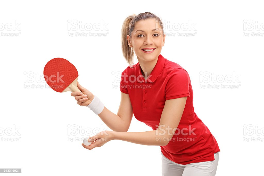 Joyful young woman playing table tennis stock photo