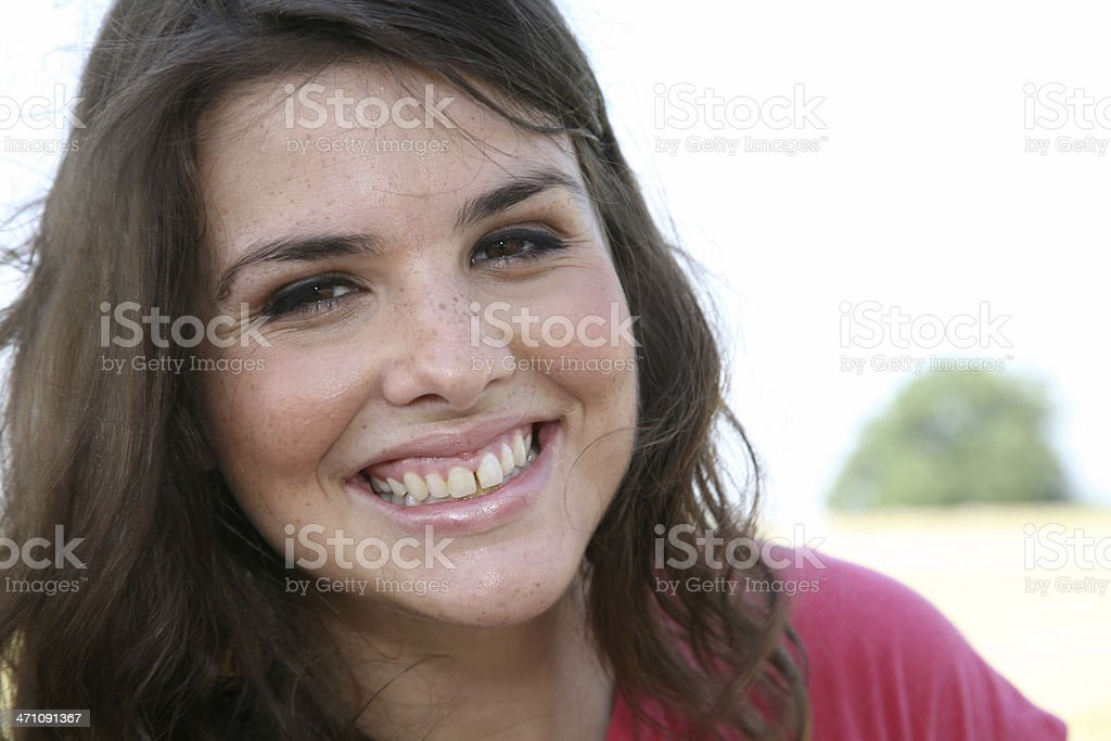 Joyful Young Woman Sitting Outdoors royalty-free stock photo