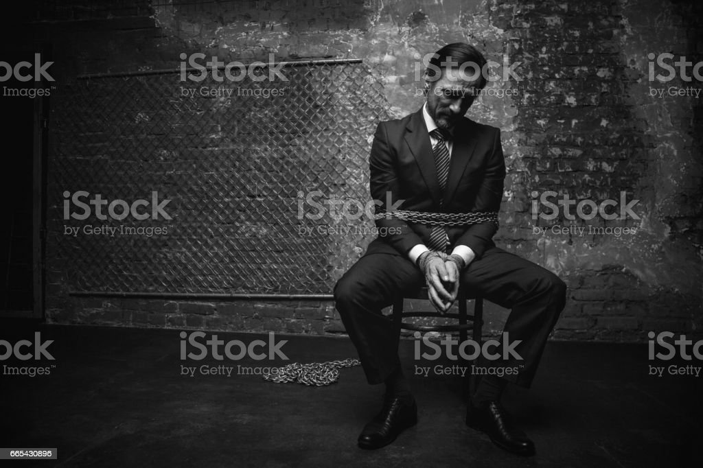 Joyless captivated man looking obedient stock photo