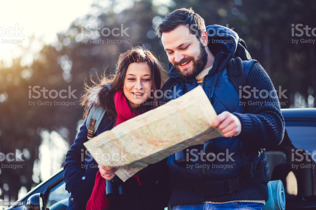Joyous People Looking At Locator Map stock photo