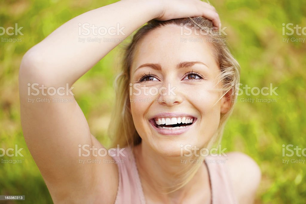 Joyous young female looking up against green background royalty-free stock photo