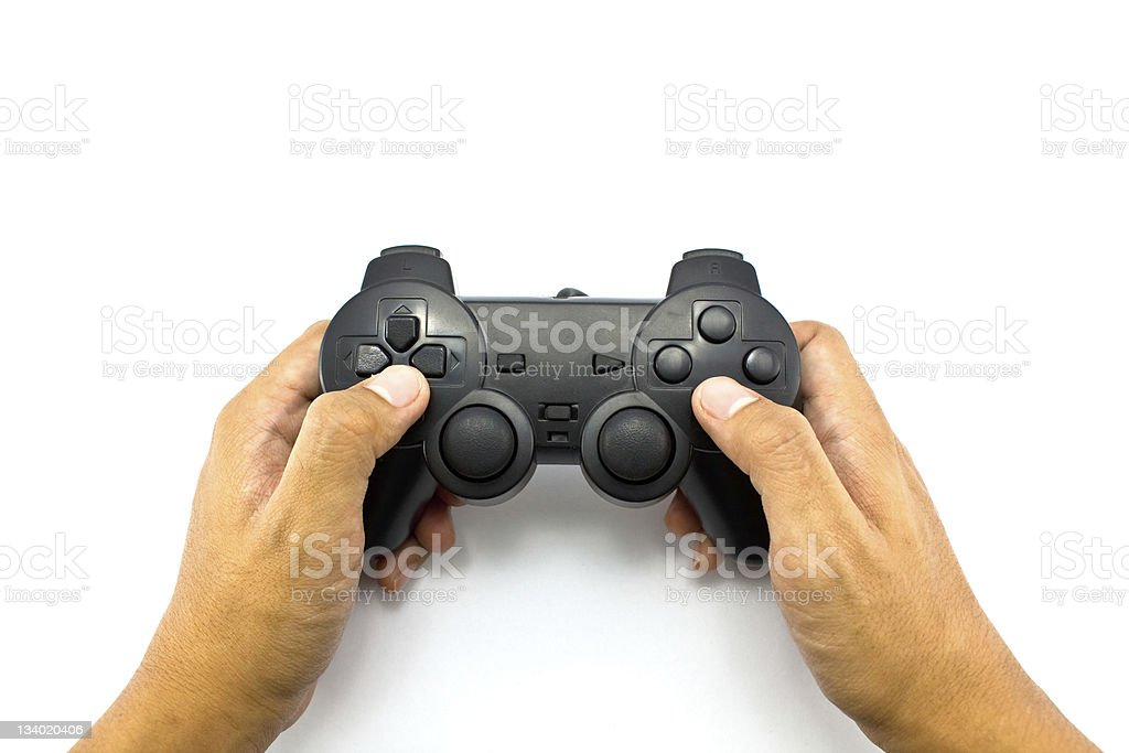 joypad in hand stock photo