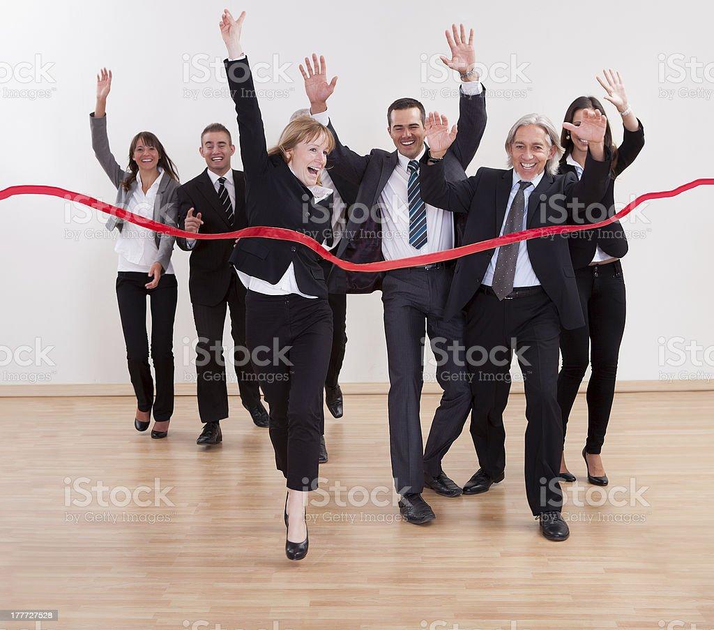 Jubilant business people celebrating royalty-free stock photo