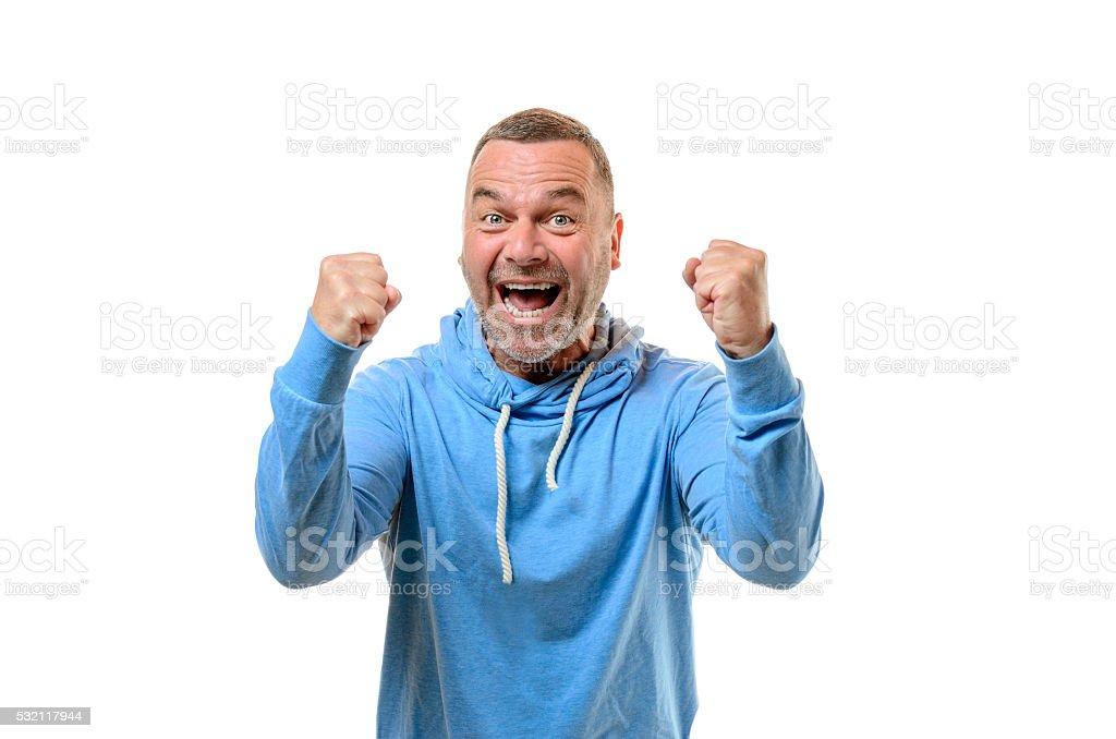 Jubilant man cheering and punching the air stock photo