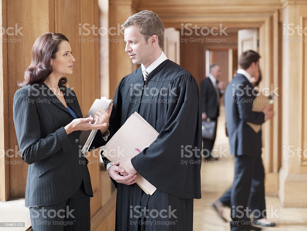 Judge and lawyer talking in corridor stock photo