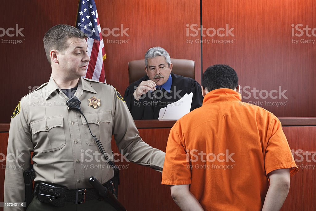 Judge and Prisoner in Courtroom stock photo