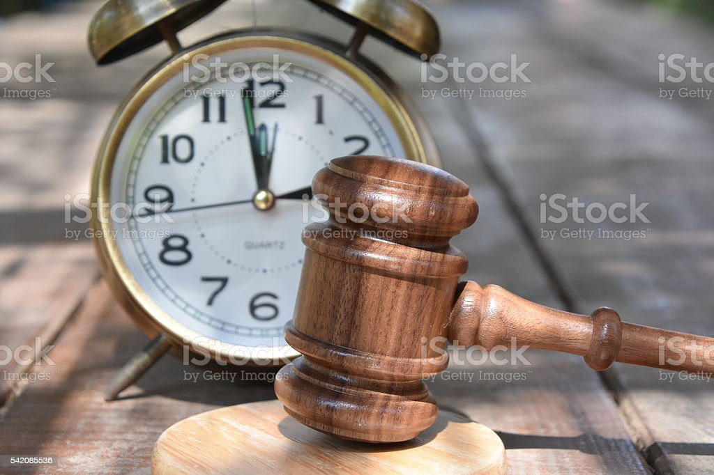 Judge gavel and Alarm Clock stock photo