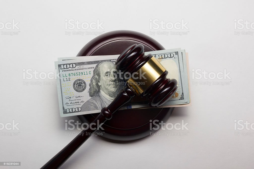 judge gavel and american dollars on white background stock photo