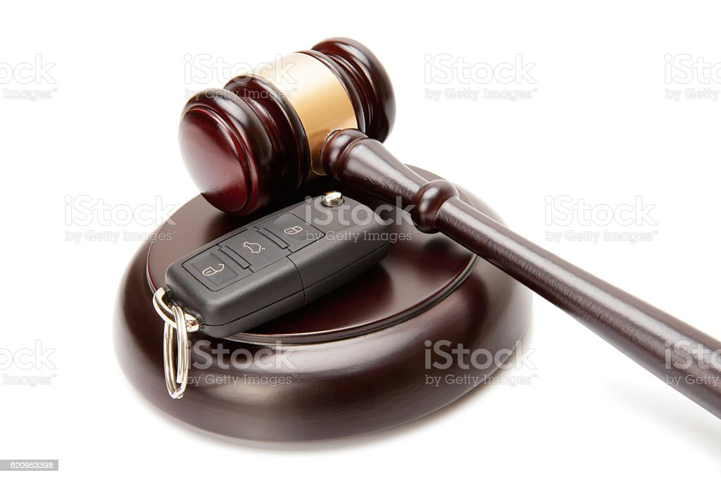 Judge gavel and car keys over soundboard stock photo