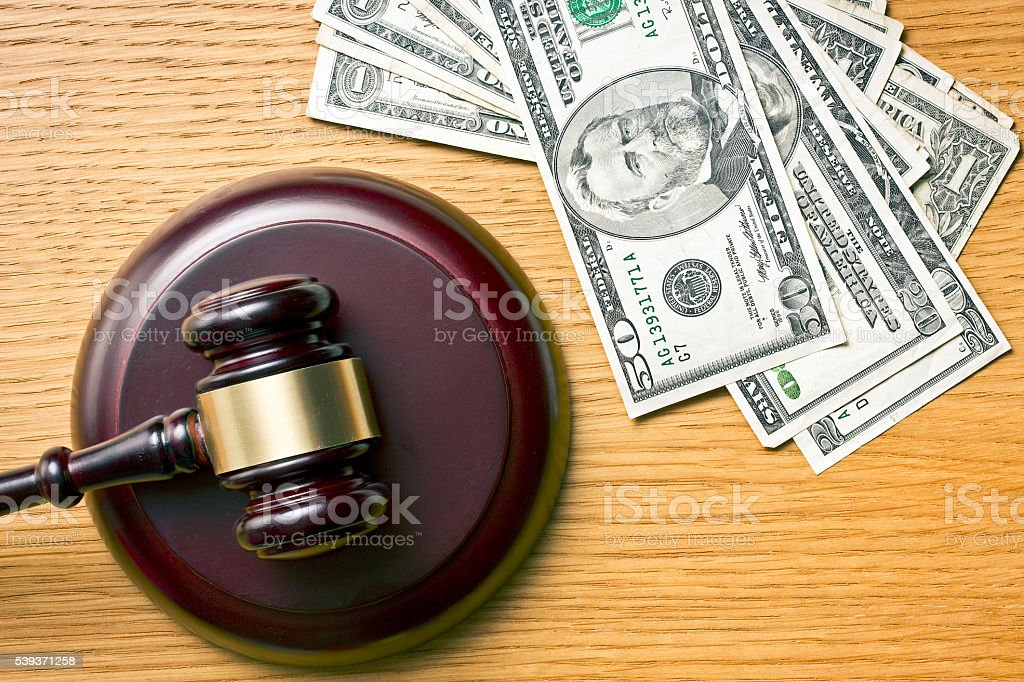 judge gavel and dollars stock photo