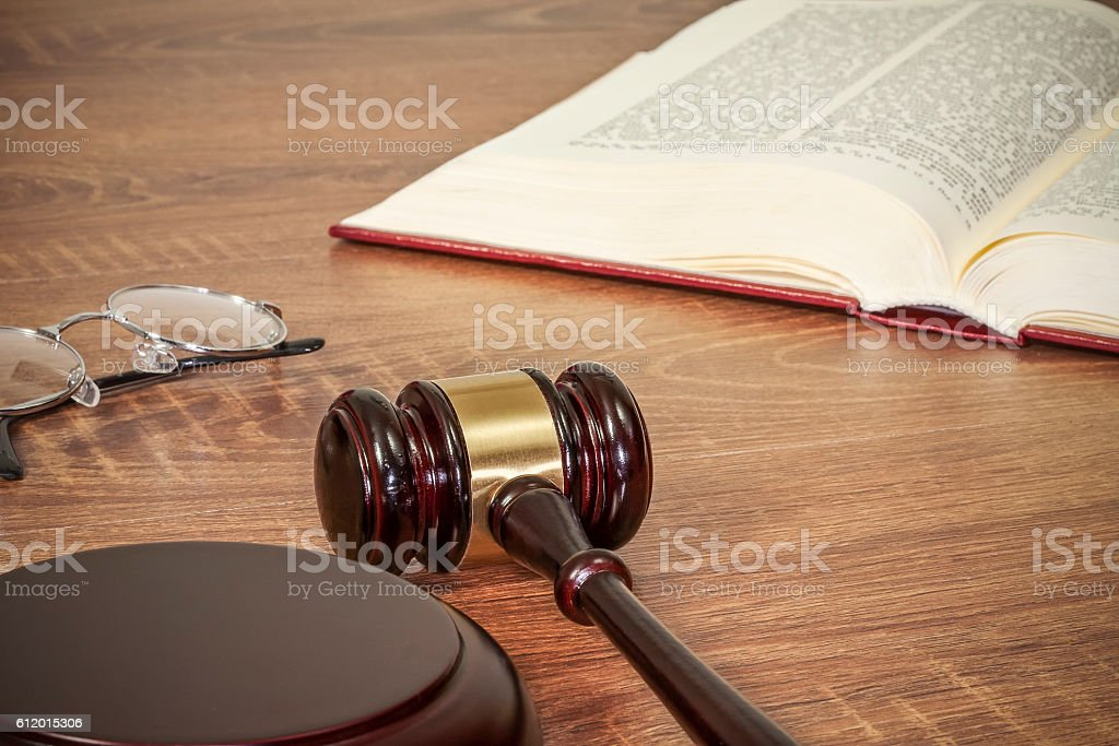 Judge gavel and old books stock photo