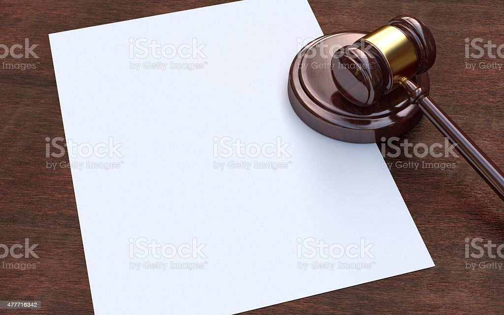 Judge gavel and paper on the brown wooden background stock photo