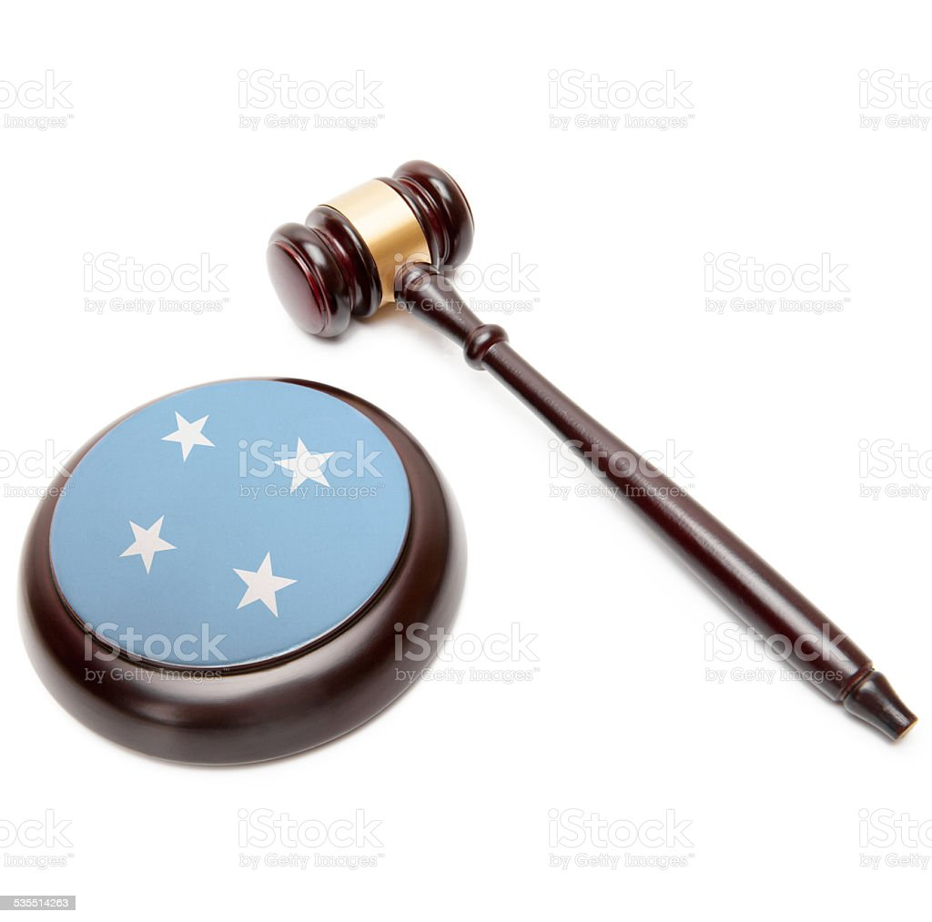Judge gavel and soundboard with flag - Micronesia stock photo