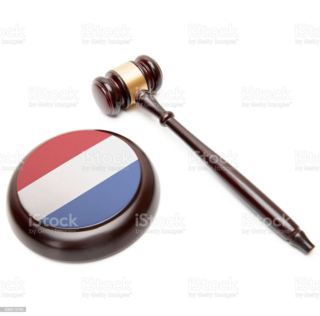 Judge gavel and soundboard with flag on it - Netherlands stock photo