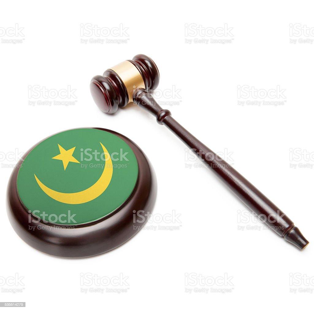 Judge gavel and soundboard with national flag - Mauritania stock photo