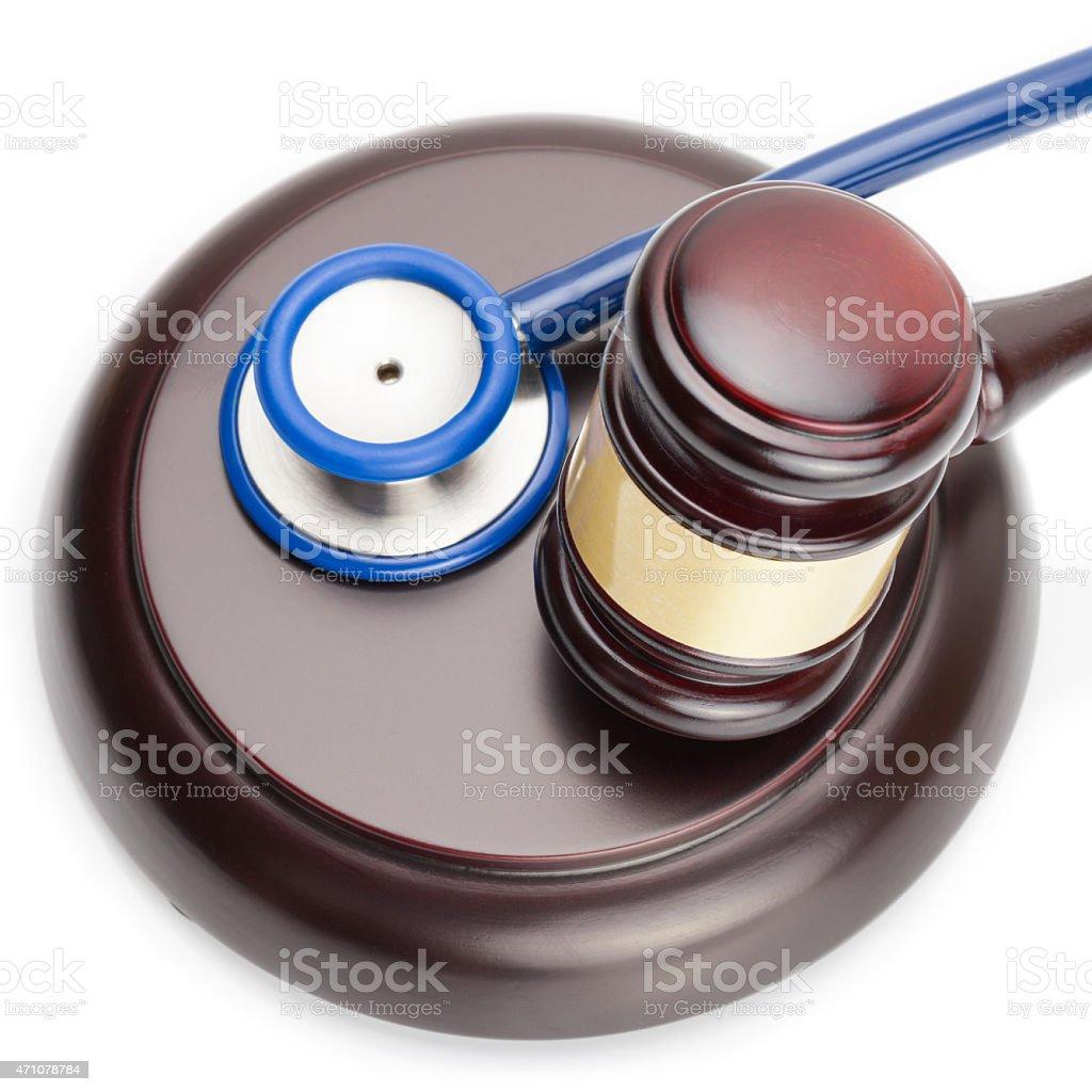 Judge gavel and stethoscope - close up shot stock photo