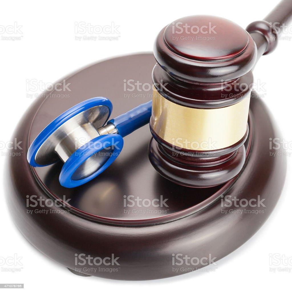 Judge gavel and stethoscope near it - close up shot stock photo