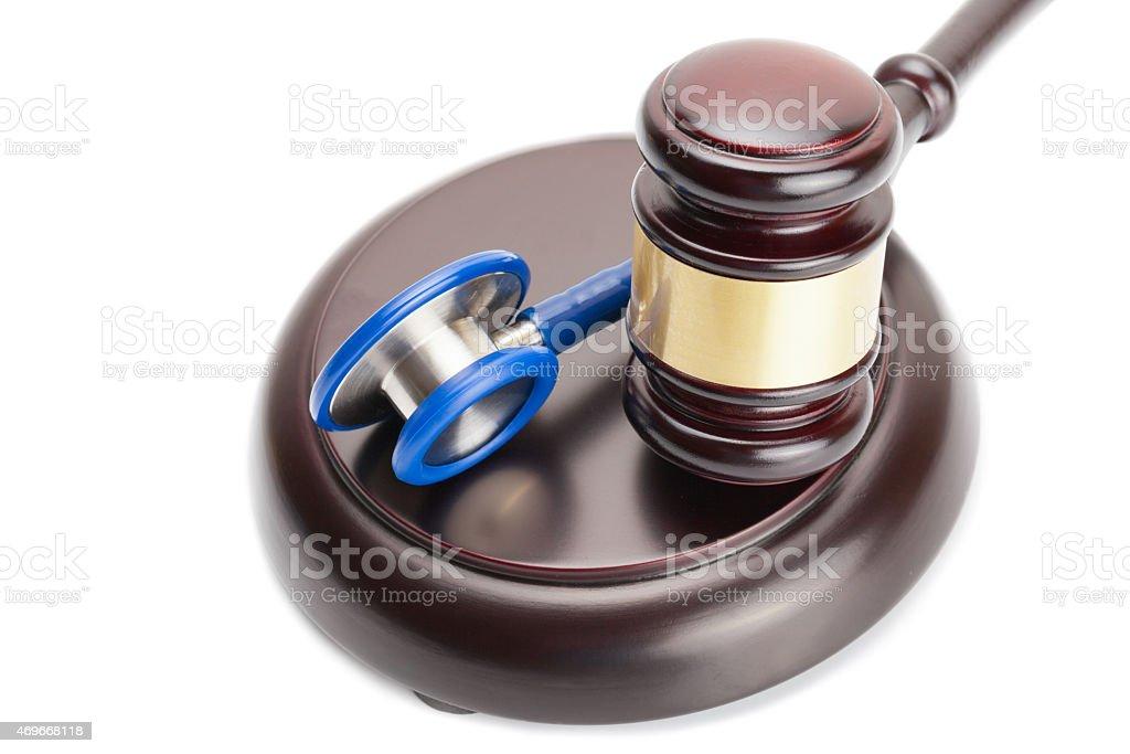 Judge gavel and stethoscope near it stock photo