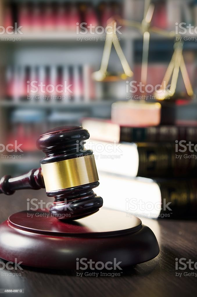 Judge gavel in court. Library with lot of books stock photo