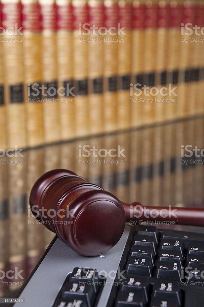 Judge gavel on computer keyboard royalty-free stock photo