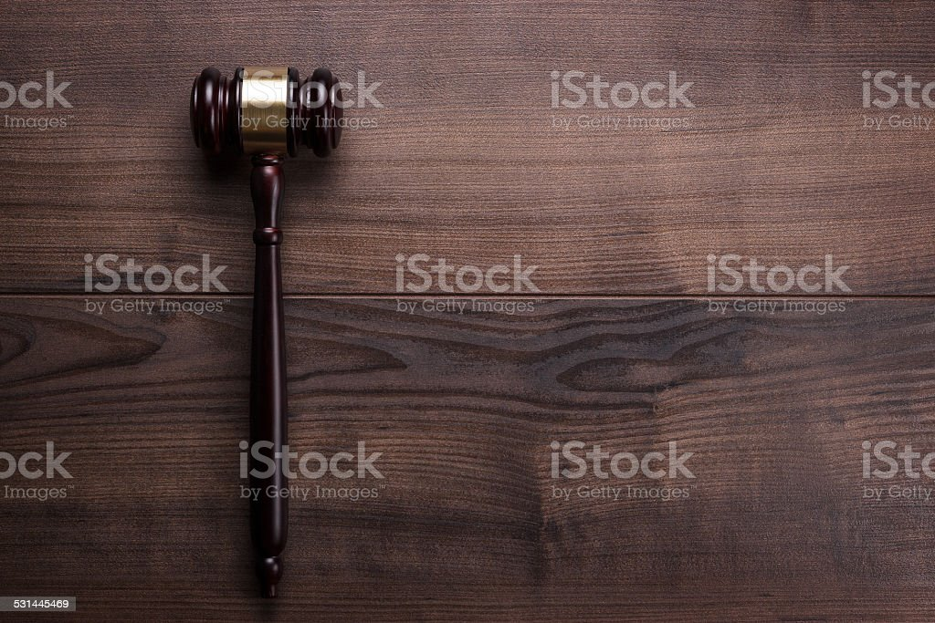 judge gavel on the brown wooden background stock photo