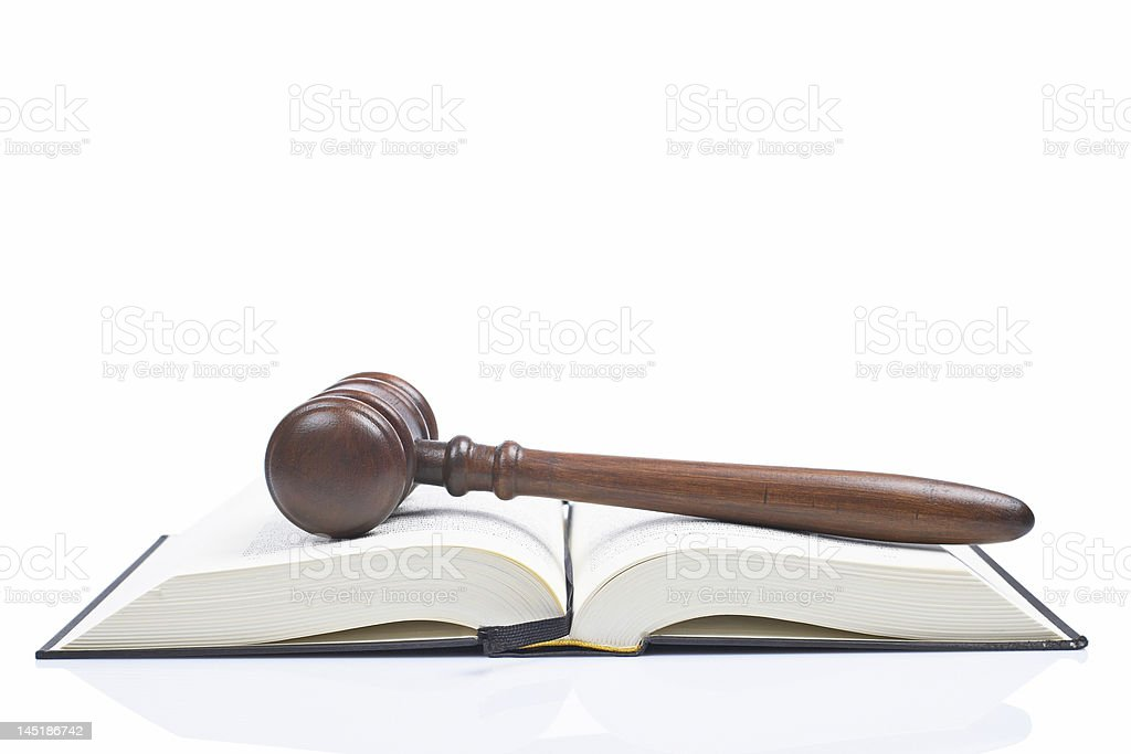 Judge gavel over opened law book against white background royalty-free stock photo