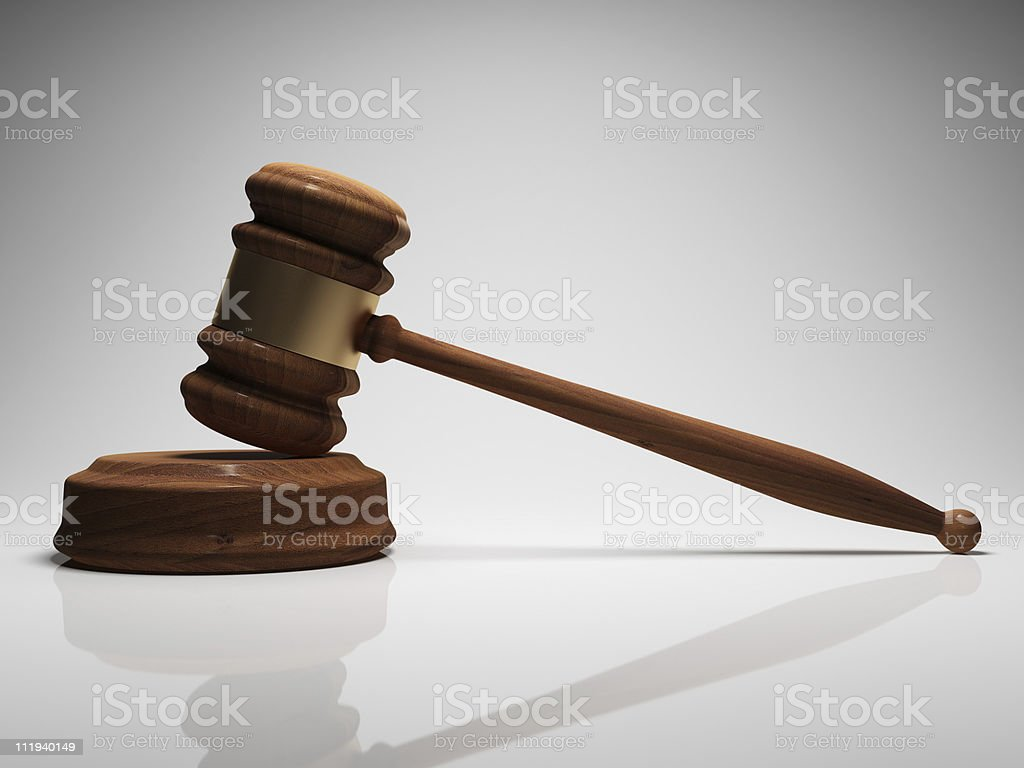 Judge gavel with reflection on table royalty-free stock photo