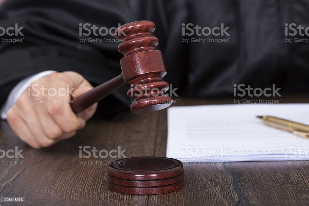 Judge Giving Verdict By Hitting Mallet stock photo
