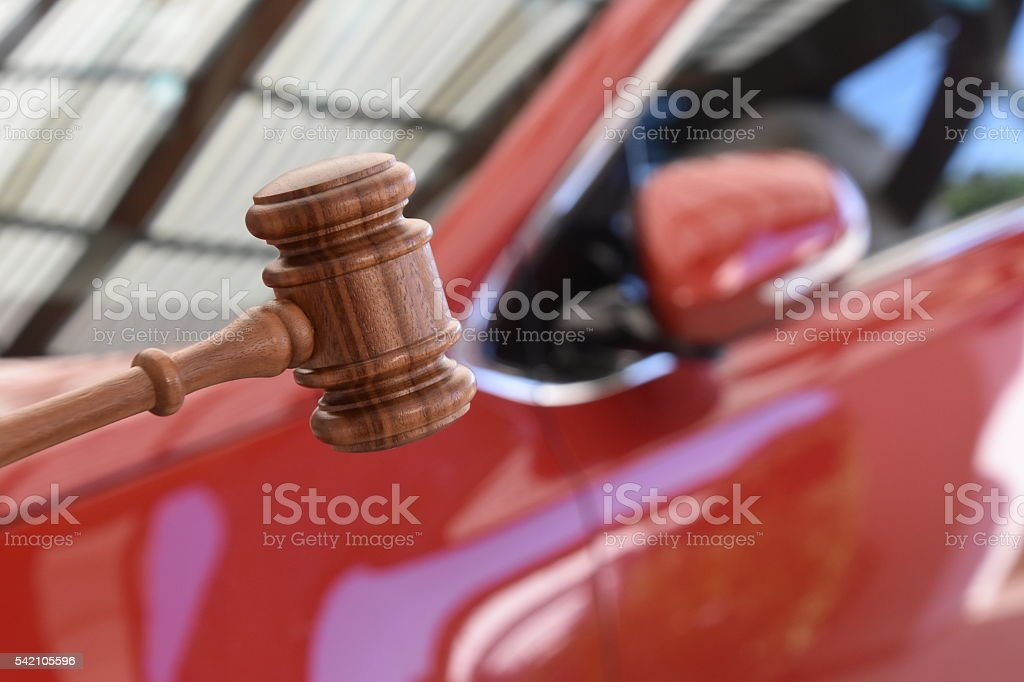 Judge hammer and car stock photo