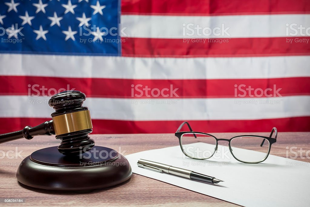 Judge Hammer and glasses on the background of USA flag stock photo