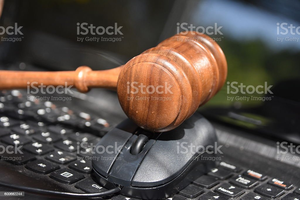 Judge hammer and laptop stock photo