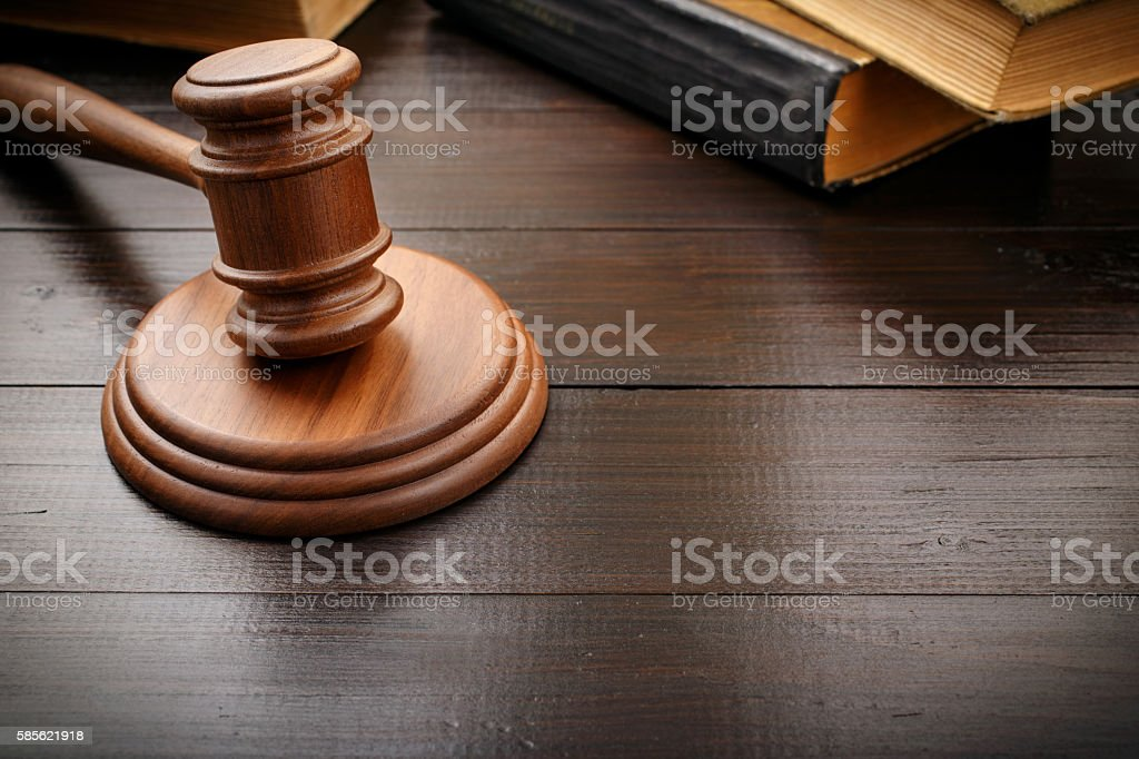 Judge hammer with old legal book stock photo