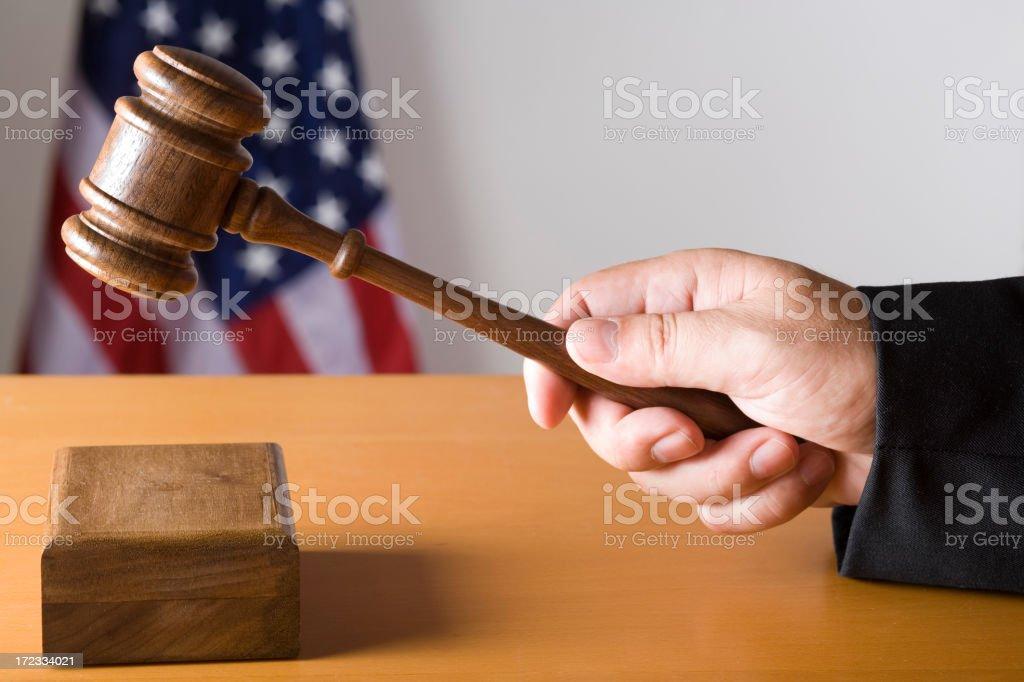Judge hitting sound box with gavel royalty-free stock photo