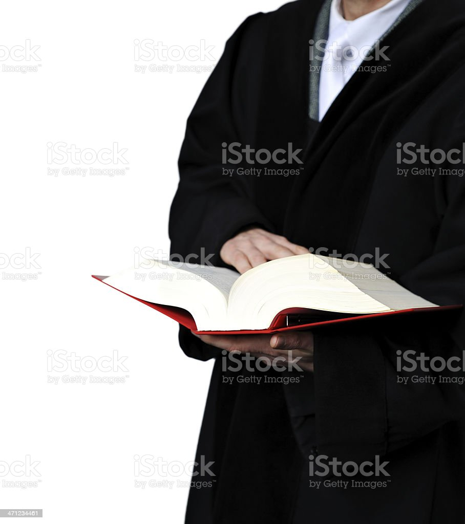 A judge holding a open law book stock photo