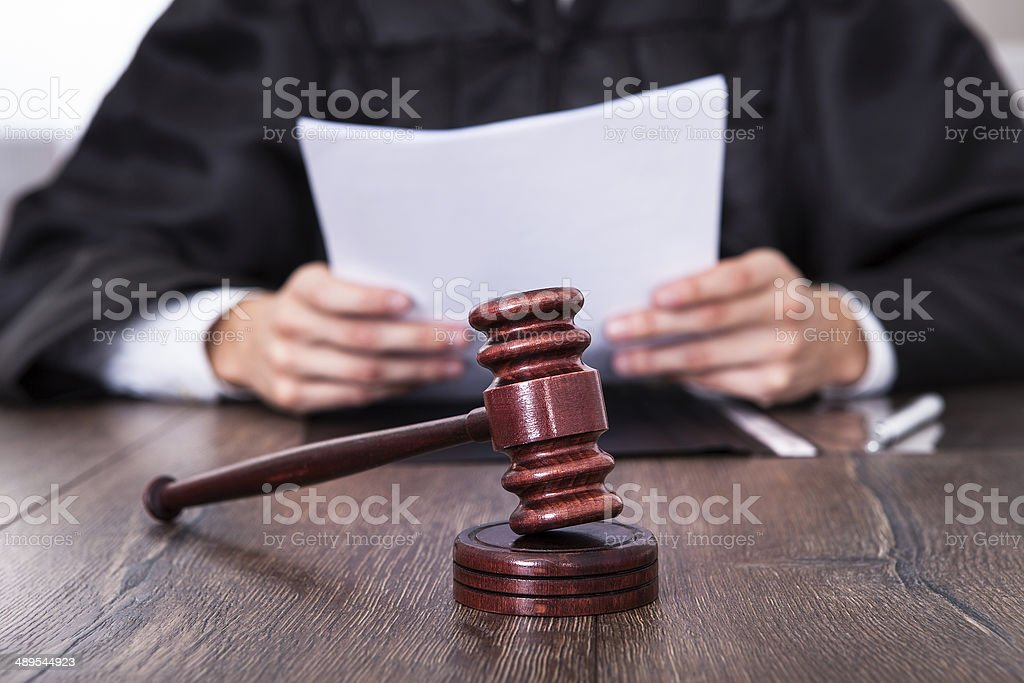 Judge Holding Documents stock photo